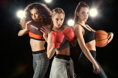 Portrait of confident sporty women with balls and boxing gloves stock photo