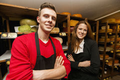 Portrait of confident store clerks in cheese shop Stock Photo