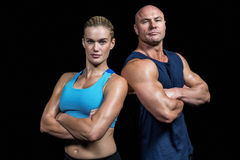 Portrait of confident strong man and woman Stock Photo