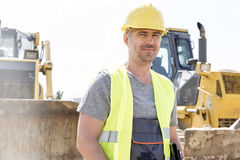 Portrait of confident supervisor standing at construction site Royalty Free Stock Image