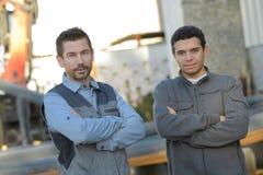 Portrait confident supervisors outside warehouse. Portrait of a confident supervisors outside warehouse Stock Image