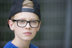 Portrait confident teenage boy with cap Royalty Free Stock Photo