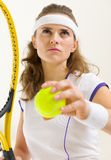 Portrait of confident tennis player ready to serve Stock Photos