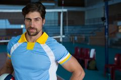 Portrait of confident volleyball player at court. Portrait of confident male volleyball player standing at court Stock Photos