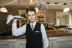 Portrait of confident waiter carrying serving tray in restaurant Stock Image