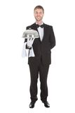 Portrait of confident waiter holding domed tray Stock Photography