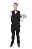 Portrait Of Confident Waiter Tray With Cloche Lid. Full length portrait of confident waiter tray with cloche lid cover over white background Royalty Free Stock Photos