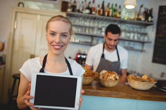 Portrait of confident waitress holding blank chalkboard Stock Photos
