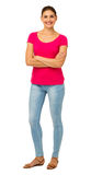 Portrait Of Confident Woman With Arms Crossed. Full length portrait of confident woman with arms crossed standing against white background. Vertical shot Royalty Free Stock Photography