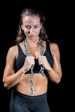 Portrait of confident woman with chain. Against black background Royalty Free Stock Images