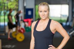 Portrait Of Confident Woman in Gym. Portrait of confident woman with hand on hip standing in gym Royalty Free Stock Images