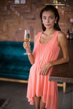 Portrait of confident woman holding a champagne flute Stock Photography