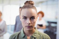 Portrait of confident woman in office. Close up portrait of confident woman in office Royalty Free Stock Photography