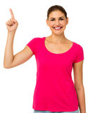 Portrait Of Confident Woman Pointing Upwards Royalty Free Stock Photography