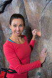 Portrait of confident woman practicing rock climbing. In fitness studio Royalty Free Stock Photos