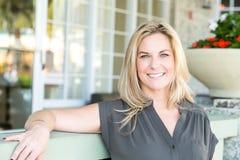 Portrait of a confident woman smiling. Portrait of a confident woman smiling outside Royalty Free Stock Photography