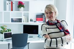 Portrait of confident woman standing with arms crossed. At home Royalty Free Stock Image