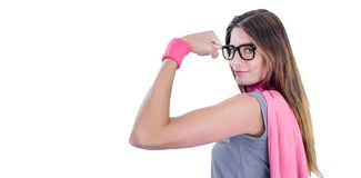 Portrait of confident woman in superhero costume. While flexing muscles on white background Stock Images