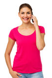 Portrait Of Confident Woman Using Smart Phone. While standing over white background. Vertical shot Stock Photography