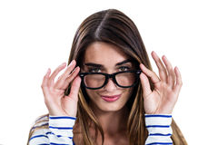 Portrait of confident woman wearing eyeglasses. Standing on white background Stock Photo