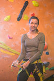 Portrait of confident woman wearing safety harness. In fitness studio Royalty Free Stock Image