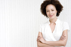 Portrait of confident woman in a white wraparound top Royalty Free Stock Image