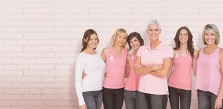 Composite image of portrait of confident women supporting breast cancer awareness Royalty Free Stock Images