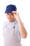 Portrait of confident worker, employee with blue cap and apron. White isolated background Stock Images