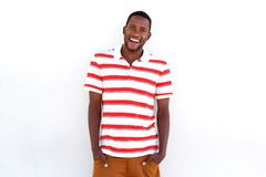 Confident young african man laughing with hands in pocket Stock Photography