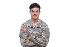 Portrait of a confident young American soldier with arms crossed Royalty Free Stock Image