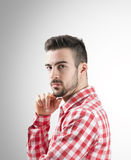 Portrait of confident young bearded man looking at camera Royalty Free Stock Photography