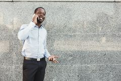 Portrait of a confident young black businessman talking on cell phone Stock Photo