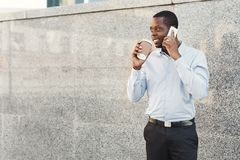 Portrait of a confident young black businessman talking on cell phone Royalty Free Stock Image