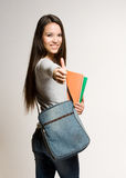 Confident young brunette student. Royalty Free Stock Image