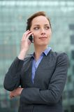 Portrait of a confident young business woman talking on phone Stock Photos