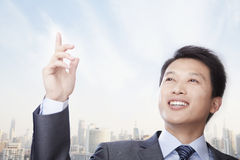 Portrait of Confident Young Businessman Gesturing, Outdoors with Cityscape Stock Images