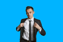 Portrait of a confident young businessman over colored background Stock Images