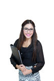 Portrait of confident young businesswoman with file folder in of Stock Image