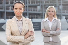 Portrait of confident young businesswomen standing arms crossed outdoors Royalty Free Stock Photography