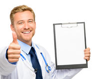 Portrait of confident young doctor on white background Stock Photo