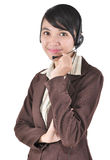 Portrait of a confident young female. Customer service agent with headset, isolated on white background Stock Image