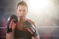 Portrait of confident young female boxer Royalty Free Stock Photo