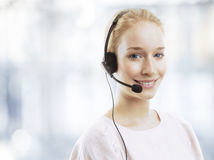 Confident young female customer service agent with headset Stock Photography