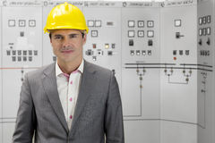 Portrait of confident young male supervisor in control room Royalty Free Stock Photography