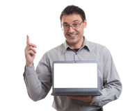 Portrait of confident young man advertising laptop Stock Photography