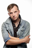 Portrait of a confident young man in jeans jacket on a white  Stock Photography