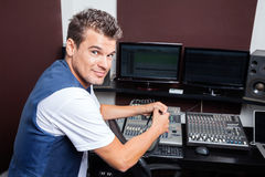 Portrait Of Confident Young Man Mixing Audio Stock Photography