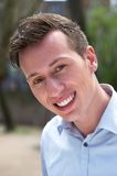 Portrait of a confident young man smiling outdoors Stock Photo