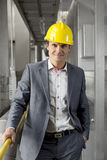 Portrait of confident young manager wearing hard hat in industry Stock Photo