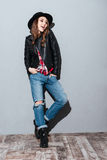Portrait of confident young woman in hat and leather jacket Royalty Free Stock Photo